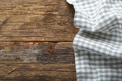 Folded tablecloth on table. Folded tablecloth on wooden table Royalty Free Stock Image