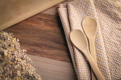 Folded tablecloth with wheat grain and wood spoon2.jpg Royalty Free Stock Image