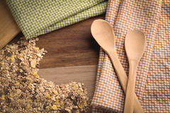 Folded tablecloth with wheat grain and wood spoon. Top view of checkered napkin with wood spoon on wooden table Stock Images