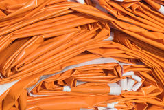 Folded Tarpaulin in Orange Stock Image
