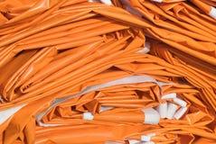 Folded Tarpaulin in Orange. Tarpaulin as Essential Construction and Household Equipment Stock Image