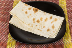 Folded of thin Armenian lavash in glass plate on bamboo mat Stock Photography