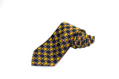 Folded  tie with a cheerful pattern on a white background Stock Photos