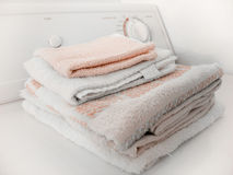 Folded Towels. Sitting on top of a clothes dryer. Focus on towels Royalty Free Stock Photo