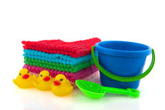 Folded towels and child play set. Towels bucket and toys for the beach Royalty Free Stock Images