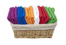 Folded Towels in a Lined Basket Stock Photo