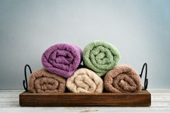 Folded towels with ranunculus Stock Photo