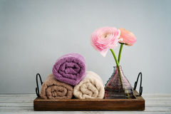 Folded towels with ranunculus Stock Image