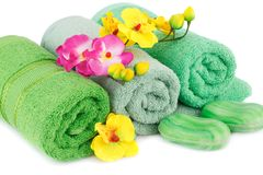 Towel, soaps and flowers. Folded towels, soaps and flowers closeup picture Royalty Free Stock Image