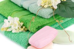 Towel, soaps and flowers. Folded towels, soaps and flowers closeup picture Stock Image