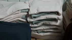 Folded tracksuits in stock of a clothing factory or shop. Folded tracksuits and t-shirts in stock of a clothing factory or shop stock footage