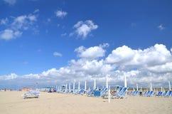 Free Folded Umbrellas And Chairs On Beautiful Beach Marina Di Vecchiano Nearby Pisa In Italy Royalty Free Stock Photo - 34147745