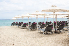 Folded umbrellas on the beach before the storm on the coast of G Stock Photography