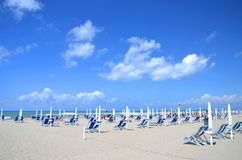 Folded umbrellas and chairs on beautiful beach Marina di Vecchiano nearby Pisa in Italy Stock Photography
