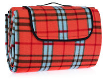 Folded up travel, picnic blanket grille with red, blue, black. Stock Image