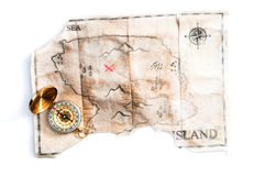 Folded vintage map of fake island with Pirates Treasure chest and compass Royalty Free Stock Photo