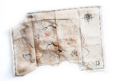 Folded vintage map of fake island with Pirates Treasure chest Royalty Free Stock Images