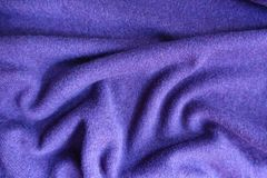 Folded violet thin simple woolen jersey fabric. Folded violet thin simple woollen jersey fabric Stock Image