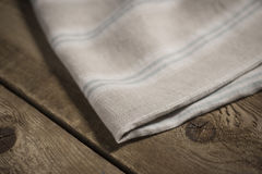 Folded White, Beige and Blue Striped Cloth or Linen Royalty Free Stock Image