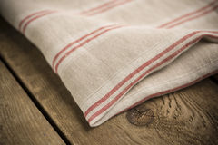 Folded White, Beige and Red Striped Cotton Fabric or Linen Royalty Free Stock Images