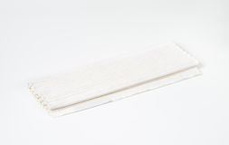 Folded white cotton placemat Stock Photography