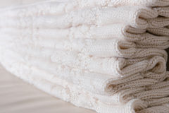 Folded white knitted throw Royalty Free Stock Images
