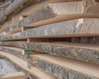 Folded wooden planks in a sawmill. Piled boards as texture.  royalty free stock photos