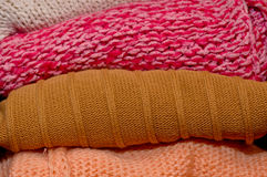 Folded woolen color sweaters Royalty Free Stock Image