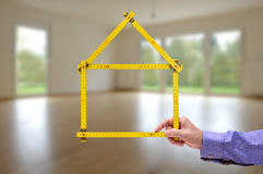 Folded yardstick in hand of real estate agent Stock Photos