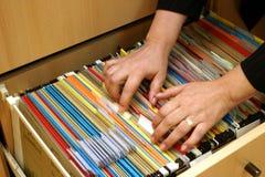 Folder. Seeking in some folders,detail Stock Image