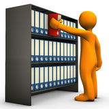Folder cabinet search. A person searching for a folder at a folder cabinet Royalty Free Stock Photo