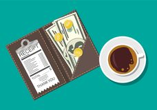 Folder with cash coins, cashier check. Coffee cup Stock Photo