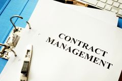 Folder and documents with contract management. Folder and documents with title contract management stock image