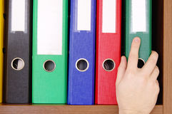 Folder with documents and a hand Royalty Free Stock Images