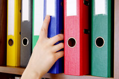Folder with documents and a hand Royalty Free Stock Photography