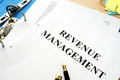Folder and documents with revenue management. royalty free stock photo