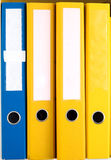 Folder with the documents on the shelves. Files put on the shelf in the workplace Stock Image