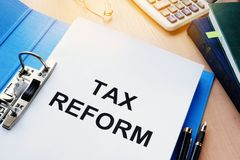 Folder and documents about Tax reform. A Folder and documents about Tax reform stock images