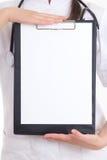 Folder in female doctor's hands Stock Image