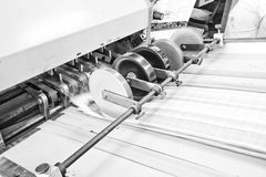 Folder. Folding machine working in printing industry Royalty Free Stock Images