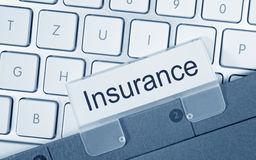 Folder for Insurance details. Folder with the text  Insurance  placed on a computer keyboard Stock Photography