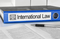 Folder with the label International Law. Blue folder with the label International Law Royalty Free Stock Photography
