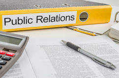 A folder with the label Public Relations Stock Image