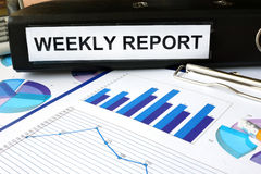 Folder with the label  weekly report Royalty Free Stock Image