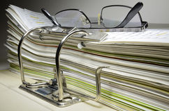Folder in a office and glasses Royalty Free Stock Photo