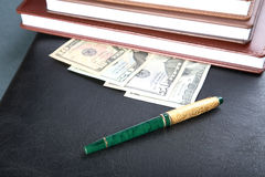 Folder organizers  pen and money Stock Photography