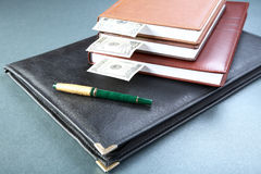Folder organizers  pen and money Stock Image