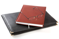 Folder for papers an organizer and glasses Stock Photo