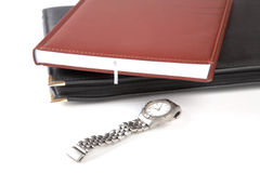Folder for papers, organizer and watch Stock Photography