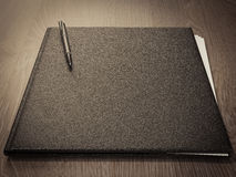 Folder for papers on a wooden texture Royalty Free Stock Images
